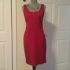 Red Body hugging dress. Spanish designer